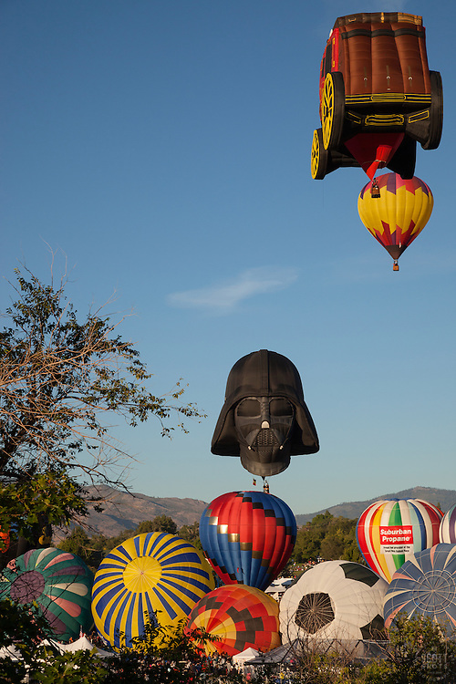 """""""Great Reno Balloon Race 10"""" - Photograph of hot air balloons lifting off during the mass ascension at the 2012 Great Reno Balloon Race."""