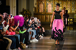 © Licensed to London News Pictures. 15/02/2020. LONDON, UK. A model presents a creation by Marie Sansome (UK) at Fashions Finest, an off-schedule show featuring emerging designers during London Fashion Week AW20 taking place at St. John's Church in Paddington.  Photo credit: Stephen Chung/LNP