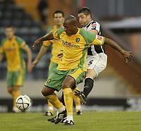 Photo: Aidan Ellis.<br /> Rochdale v Norwich City. Carling Cup. 28/08/2007.<br /> Norwich's Dion Dublin is challenged by Rochdale's John Doolan