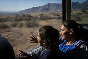 Orfa, a Honduran migrant seeking asylum, and her daughter Rachel look out the window of a Greyhound bus during a leg of their asylum journey from El Paso, Texas, U.S., to Portales, New Mexico, U.S., May 16, 2018. Orfa must await future court dates to learn whether her asylum claim will be granted, allowing her to stay in the U.S., or if it will be denied and she will be issued a deportation order.