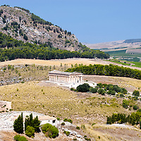 Segesta. Sicily. Italy. Panoramic view of the Greek Doric Temple of Segesta which stands glorious in magnificent isolation on a low hill in the midst of verdant country side and framed by mountains.