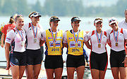 Lucerne, Switzerland.  NZL M2- , women's pair medalist left USA W2-, Centre NZL W2- anf right, CAN W2- women's pair. 2010 FISA World Cup. Lake Rotsee, Lucerne.  09:10:32   Sunday  11/07/2010.  [Mandatory Credit Peter Spurrier/ Intersport Images]