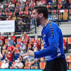Jubelt nach einem gehaltenen Schuss / Wurf Ludwigshafens Martin Tomovski (Nr.12)  beim Spiel in der Handball Bundesliga, Die Eulen Ludwigshafen - THW Kiel.<br /> <br /> Foto © PIX-Sportfotos *** Foto ist honorarpflichtig! *** Auf Anfrage in hoeherer Qualitaet/Aufloesung. Belegexemplar erbeten. Veroeffentlichung ausschliesslich fuer journalistisch-publizistische Zwecke. For editorial use only.