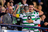 Mikael Lustig (#23) of Celtic congratulates Scott Brown (#8) of Celtic as they lift the Betfred Cup following the Betfred Cup Final between Celtic and Aberdeen at Celtic Park, Glasgow, Scotland on 2 December 2018.