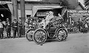 """1304A-160B. """"First auto in Portland"""" June 10, 1914. Rose Festival Parade. see Oregonian 6/11/14 pg. 9 """"Ancient Specimen Snorts, But Goes. It coughed and wheezed its way along the street, but despite its age, it kept on going. It was one of the first models  of the Haynes-Apperson. It was brought to Portland in 1900 by E. H. Wemme"""