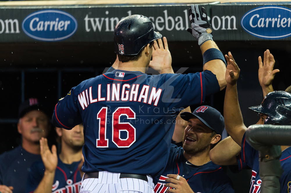 Josh Willingham (16) of the Minnesota Twins celebrates with his teammates after hitting a game-tying 3-run home run off Doug Fister (58) of the Detroit Tigers (not shown) on August 14, 2012 at Target Field in Minneapolis, Minnesota.  The home run was Willingham's 30th of the season setting a career single-season best for him.  The Tigers defeated the Twins 8 to 4.  Photo: Ben Krause
