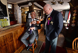 Former Ukip leader Nigel Farage has a pint in a pub in South Thanet with local candidate Stuart Piper while on the general election campaign trail.
