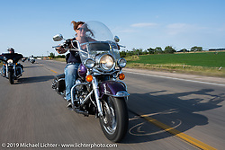 Laura Mastropolo on the Harley Owners Group (HOG) ride out from the Full Throttle Saloon during the Sturgis Motorcycle Rally. SD, USA. Thursday, August 12, 2021. Photography ©2021 Michael Lichter.