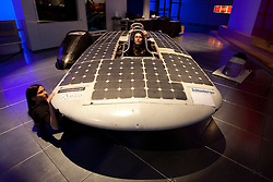 © Licensed to London News Pictures. 08/03/2013. London, UK. Cambridge University Eco Racing Team members Alice Taylor (in car) and Lucy Fielding (L), pose with their solar powered car 'Endeavour', an entrant to the 2011 World Solar Challenge, at a photocall ahead of an event celebrating women in science at the Science Museum in London today (08/03/2013).. The event, held as part of a three day festival called 'High Performance' and opening at the Science Museum on Friday the 8th of March, marks the extraordinary woman in science as part of International Women's Day. Photo credit: Matt Cetti-Roberts/LNP