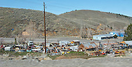 a junkyard greets visitors to Austin, Nevada from the east.