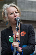 Extinction Rebellion co-founder Dr Gail Bradbrook addresses environmental activists in front of the Mansion House before a Blood Money March through the City of London on 27th August 2021 in London, United Kingdom. Extinction Rebellion were intending to highlight financial institutions funding fossil fuel projects, especially in the Global South, as well as law firms and institutions which facilitate them, whilst calling on the UK government to cease all new fossil fuel investment with immediate effect.