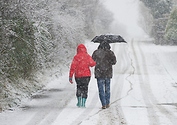 © Licensed to London News Pictures. 14/01/2013..Saltburn, Cleveland, England..A couple walk in heavy snow in Saltburn in Cleveland as parts of North Yorkshire and East Cleveland saw heavy snow fall today.   ..Photo credit : Ian Forsyth/LNP