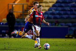 George Maris of Mansfield Town chases down Lloyd Isgrove of Bolton Wanderers - Mandatory by-line: Ryan Crockett/JMP - 17/02/2021 - FOOTBALL - One Call Stadium - Mansfield, England - Mansfield Town v Bolton Wanderers - Sky Bet League Two
