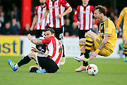Brentford midfielder, Sam Saunders (7) fouling Fulham defender, Fernando Amorebieta (45) during the Sky Bet Championship match between Brentford and Fulham at Griffin Park, London, England on 30 April 2016. Photo by Matthew Redman.