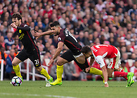 Football - 2016 / 2017 Premier League - Arsenal vs. Manchester City.<br /> <br /> Alexis Sanchez of Arsenal grabs at the shorts of Sergio Aguero of Manchester City as he tries to break free at The Emirates.<br /> <br /> COLORSPORT/DANIEL BEARHAM