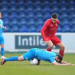 TELFORD COPYRIGHT MIKE SHERIDAN Adam Walker of Telford bundles over Gary Roberts during the Vanarama Conference North fixture between AFC Telford United and Chester at the 1885 Arena Deva Stadium on Saturday, December 21, 2019.<br /> <br /> Picture credit: Mike Sheridan/Ultrapress<br /> <br /> MS201920-035