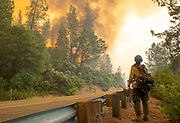 The Tallac Hotshots crew inspect along Highway 299 for hotspots in the area as the Carr Fire approaches them on Friday, July 27, 2018, in Shasta County, Calif.