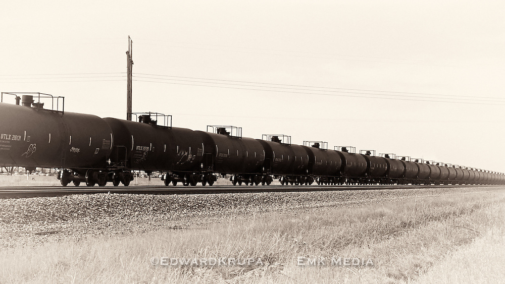 Long trains of rail tank cars filled with crude oil from North Dakota, which is experiencing an oil boom, speed to refineries in the midwest and west coast.