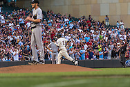 Brian Dozier #2 of the Minnesota Twins rounds the bases after hitting a home run off Chris Sale #49 of the Chicago White Sox on June 19, 2013 at Target Field in Minneapolis, Minnesota.  The Twins defeated the White Sox 7 to 4.  Photo: Ben Krause