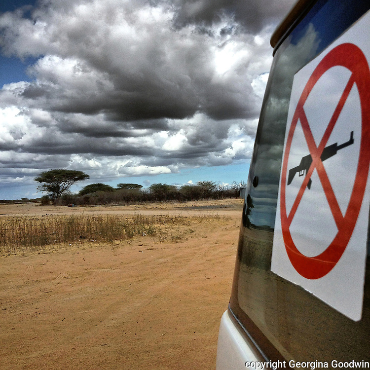 Anti-weapons sign on a Non-Government Organisation (NGO) vehicle at the airstrip in Dadaab town. Dadaab is located approximately 100 kilometers from the Kenya-Somalia border. It is situated in the Garissa District.Until recently, the local population traditionally consisted of nomadic Somali camel and goat herders. Now Dadaab hosts people that have fled various conflicts in the larger Eastern Africa region. Most have come as a consequence of the civil war and drought in southern Somalia, including both Somalis and members of Somalia's various ethnic minority groups. Dadaab is now considered the worldÕs largest refugee camp with 464,000 registered refugees, 115,000 of which arrived in 2011 from southern Somalia due to conflict and drought. 28May2012
