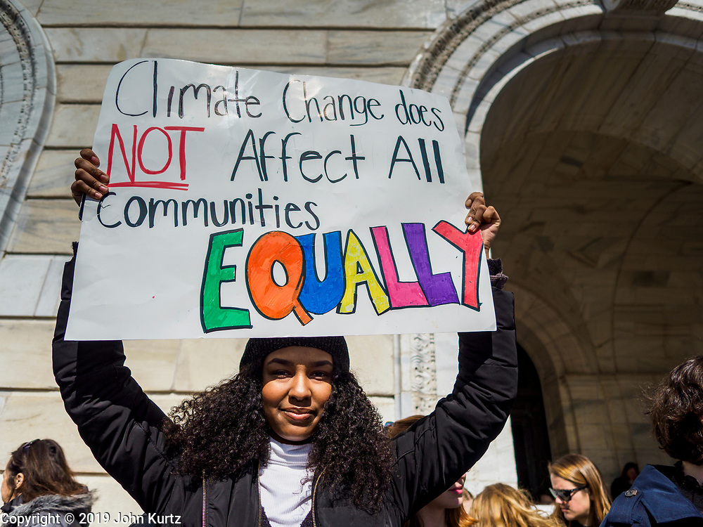"""15 MARCH 2019 - ST. PAUL, MINNESOTA, USA: A high school student holds up sign during the MN Youth for Climate Justice """"Climate Strike"""" at the Minnesota State Capitol in St. Paul, MN. Thousands of high school students braved below freezing temperatures and biting winds to demand action on climate change. The Minnesota Climate Strike was inspired by the strike by Greta Thunberg, a Swedish high school student, who started a climate strike at her school in August 2018.       PHOTO BY JACK KURTZ"""