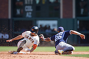 San Francisco Giants right fielder Hunter Pence (8) beats a tag by San Diego Padres third baseman Yangervis Solarte (26) during a second base steal at AT&T Park in San Francisco, Calif., on September 14, 2016. (Stan Olszewski/Special to S.F. Examiner)