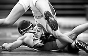 Boston University freshman, Bubba McGinley, competes with Billy Chamberlain of Sacred Heart University during a match at Boston University.