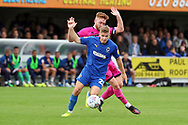 AFC Wimbledon midfielder Max Sanders (23) beating Rochadale attacker Callum Camps (10) during the EFL Sky Bet League 1 match between AFC Wimbledon and Rochdale at the Cherry Red Records Stadium, Kingston, England on 5 October 2019.