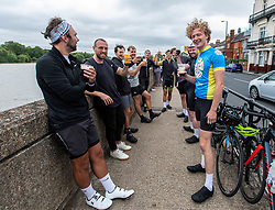 "© Licensed to London News Pictures. 04/07/2020. London, UK. A group of cyclists stop for a pint of beer along the River Thames at Barnes in South West London on ""Super Saturday"" as members of the public flock to pubs, restaurants, hairdressers, hotels and campsites for the first time in over 100 days as the unlocking of the coronavirus pandemic restrictions continues. Photo credit: Alex Lentati/LNP"