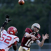Ashley's Chris Kane passes against Hoke County's Tobias Edge-Campbell Friday August 23, 2013 at Ashley High School. (Jason A. Frizzelle) This collection of images is from the 2013 High School Football in the Cape Fear region.
