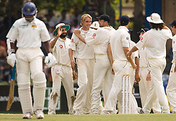 File photo dated 12-12-2007 of England's Stuart Broad celebrates with teammates after dismissing Sri Lanka's Chaminda Vaas during the second Test match at Sinhalese Sports Club, Colombo.