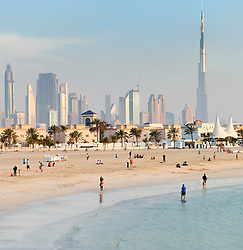 View of modern high-rise skyline of Dubai from Jumeirah Open Beach in Dubai United Arab Emirates