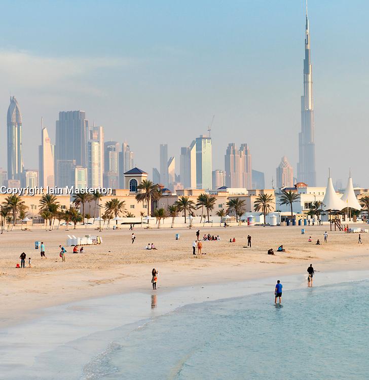 View of modern high-rise skyline of Dubai from Jumeirah Open Beach in Dubai United Arab Emirates
