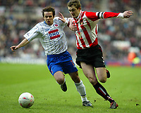 SATURDAY 3RD JANUARY 2004<br /> SUNDERLAND V HARTLEPOOL FA CUP 3RD ROUND<br /> PIC SCOTT HEPPELL-SPORTSBEAT IMAGES<br /> POOLS CHRIS SHUKER BATTLES WITH AND BEATS GEORGE MC CARTHEY TO THE BALL