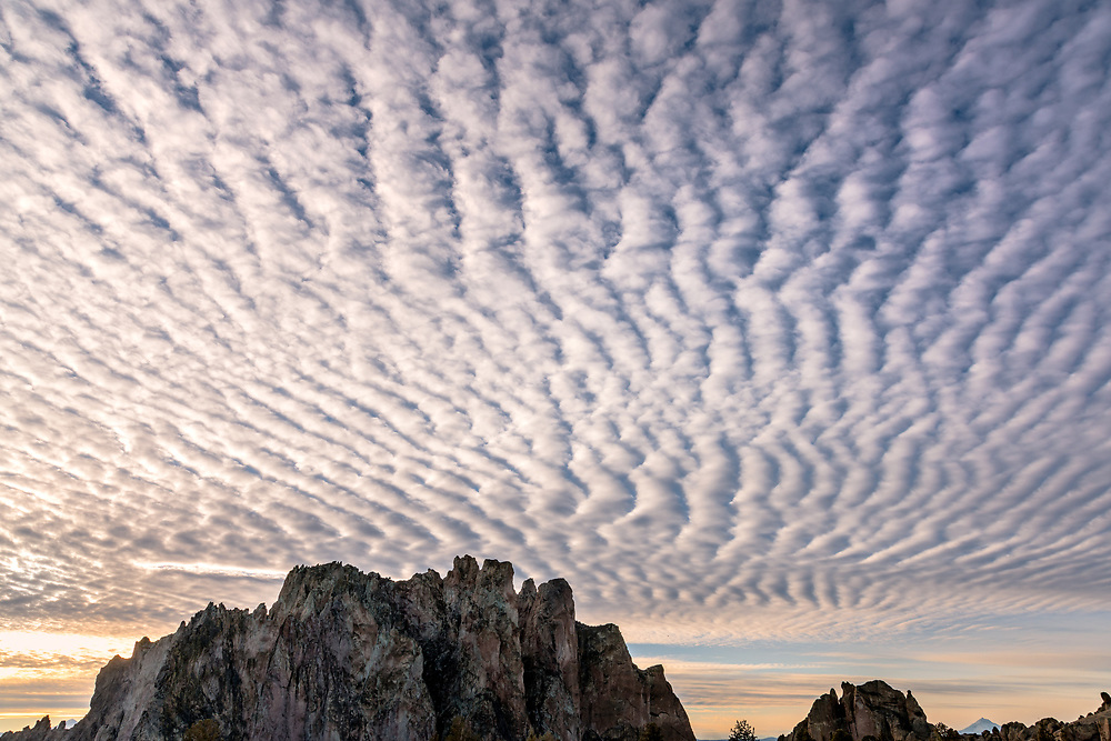 A dramatic display of altostratus clouds fills the sky above Smith Rock State Park in Central Oregon.