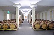 Oak barrel aging and fermentation cellar. Chateau Nenin, Pomerol, Bordeaux, France