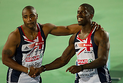 Silver medallist Mark Lewis-Francis of Great Britain consoles Dwain Chambers of Great Britain after he came 4th in the Mens 100m Final during day two of the 20th European Athletics Championships at the Olympic Stadium on July 28, 2010 in Barcelona, Spain. (Photo by Vid Ponikvar / Sportida)
