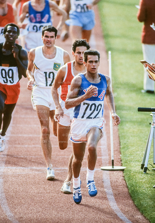 EDMONTON, CANADA - OCTOBER 11:  Actor Robby Benson #722 of the USA plays the role of Billy Mills in the movie Running Brave filmed in Commonwealth Stadium in Edmonton, Canada in this photograph taken October 11, 1982 on location during production of the film.  The movie recreates Billy Mills' historic win in the 1964 Olympic Games 10000 meter race.  Other visible athletes include Greg Coyes #615 playing the role of Mohammed Gammoudi of Tunisia and Darrell Menard #12 playing Ron Clark of Australia.   (Photo by David Madison/Getty Images)