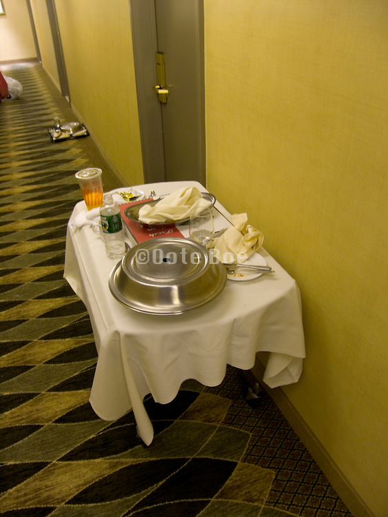 hall in a hotel with breakfast table placed outside room