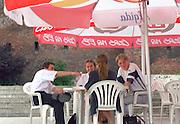 Friends age 23 eating at outdoor sidewalk cafe.  Torun Poland