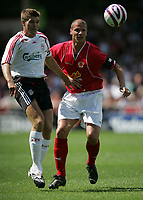 Photo: Paul Thomas.<br />Crewe Alexandra v Liverpool. Pre Season Friendly. 14/07/2007.<br /><br />Steven Gerrard (L) of Liverpool battles Neil Cox.
