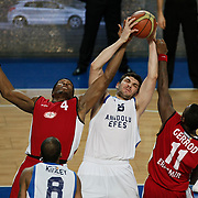 Anadolu Efes's Estaban Batista (C) and Erdemir's Kzell Wesson (L) during their Turkish Basketball League match Anadolu Efes between Erdemir at Arena in Istanbul, Turkey, Wednesday, January 28, 2012. Photo by TURKPIX