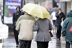 © Licensed to London News Pictures. 14/12/2012.Wet weather returns today (14.12.12) in Kent..After the frost and the snow wind and heavy rain now hits. Shoppers in Orpington High Street in Kent getting wet..Photo credit : Grant Falvey/LNP