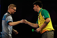 Ron Meulenkamp v Diogo Portela fist bump before their Round 1 match during the Darts World Championship 2018 at Alexandra Palace, London, United Kingdom on 18 December 2018.