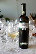 Wine glasses in the tasting room. Bottle of Zilavka Mostar Vrhunsko Suho Vino white wine. Vinarija Citluk winery in Citluk near Mostar, part of Hercegovina Vino, Mostar. Federation Bosne i Hercegovine. Bosnia Herzegovina, Europe.
