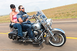 Tye Lofts rides back to Sturgis after the annual Michael Lichter - Sugar Bear Ride hosted by Jay Allen with the Easyriders Saloon during the Sturgis Black Hills Motorcycle Rally. SD, USA. Sunday, August 3, 2014. Photography ©2014 Michael Lichter.