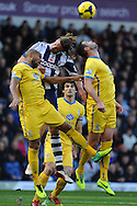 WBA's Jonas Olsson © gets squeezed by the Palace defence. Barclays Premier League match, West Bromwich Albion v Crystal Palace at the Hawthorns in West Bromwich on Saturday 2nd Nov 2013. pic by Andrew Orchard, Andrew Orchard sports photography,