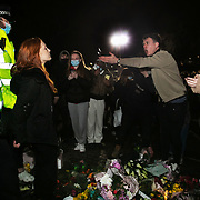 Hundreds of people gathered at a peaceful vigil for Sarah Everard on Clapham Common in South London on the 13th of March 2021, London, United Kingdom. Sarah Everard went missing on 3 March after setting off at 9pm from a friend's house to make her two-and-a-half-mile journey home and was days later found murdered. A man is asking police what they are doing arresting people and to let them go. People had turned out to pay respect and love and mourn Sarah Everard as well as all the women and girls who on a daily basis are hurt by men. It was an event full of sadness and reflection and anger but peaceful. The vigil was not sanctioned by police because of Covid restrictions and the police decided to arrest a number of people in an attempt to break up the peaceful and highly emotional vigil. The event took place around the band stand on the common and speeches were held from the stand till police confiscated the sound equipment. The police have since been highly criticized for their handling of the event.
