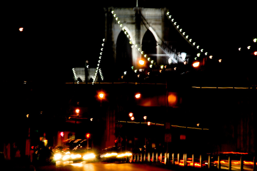 An artsy picture of the Brooklyn Bridge by night, on its 125th anniversary, Brooklyn, New York.