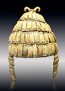 """Boar's tusk helmet with cheek guards and double bone hook on top. Tomb 515 Mycenae, Greece. 14th-15th century BC. National Archaeological Museum, Athens.. The Boar's tusk helmet was described in the Iliad as follows """"Meriones gave Odysseus a bow, a quiver and a sword, and put a cleverly made leather helmet on his head. On the inside there was a strong lining on interwoven straps, onto which a felt cap had been sewn in. The outside was cleverly adorned all around with rows of white tusks from a shiny-toothed boar, the tusks running in alternate directions in each row.<br /> —Homer, Iliad 10.260–5"""" .<br /> <br /> If you prefer to buy from our ALAMY PHOTO LIBRARY  Collection visit : https://www.alamy.com/portfolio/paul-williams-funkystock/mycenaean-art-artefacts.html . Type -   Athens    - into the LOWER SEARCH WITHIN GALLERY box. Refine search by adding background colour, place, museum etc<br /> <br /> Visit our MYCENAEN ART PHOTO COLLECTIONS for more photos to download  as wall art prints https://funkystock.photoshelter.com/gallery-collection/Pictures-Images-of-Ancient-Mycenaean-Art-Artefacts-Archaeology-Sites/C0000xRC5WLQcbhQ"""